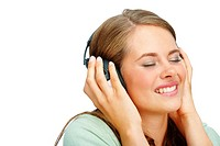 Closeup of a cute young woman listening to music on headset over white background