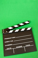 clapperboard color black on a green background