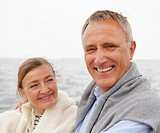 Happy senior couple enjoying themselves together on a vacation on the sea