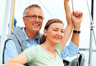 Cute mature couple on a sailboat while on a voyage
