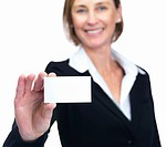 Portrait of happy middle aged businesswoman showing business card isolated over white background