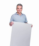 Portrait of a handsome senior man holding a blank billboard isolated on white