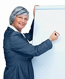 Elderly business woman giving a presentation using a flipchart , place your text