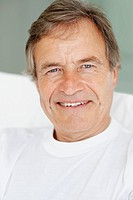 Closeup portrait of retired senior man smiling