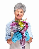 Beautiful older woman holding a bunch of flowers over white background
