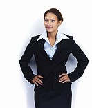 A smiling African American business woman looking away in thought on white background