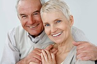 Closeup portrait of a cute senior couple smiling together