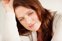 Closeup of a pretty mature woman smiling thoughtfully