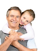 Portrait of little girl playing with her grandfather on white background