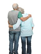 Rear view of retired old couple standing together on white background