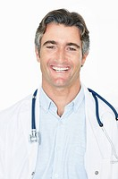 Closeup portrait of a successful middle aged male doctor standing against white