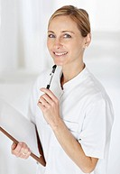 Portrait of a successful mature female nurse holding a notepad and a pen