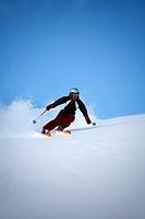 Skier going downhill, Abisko, Lapland, Sweden.