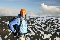 A woman on a mountain peak, Kebnekaise, Lapland, Sweden.