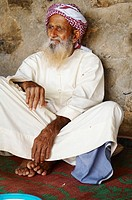 Middle East, Oman, old shepherd in Mussandam area living in moutains.