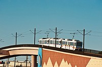 Metro Denver RTD Lightrail train on flyover bridge on Santa Fe Drive at West Union Avenue, Littleton, Colorado USA