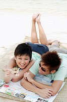young asian couple with toy airplane