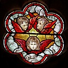 A stained glass window depicting Cherubs, St Denys Church, Little Compton, Warwickshire