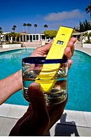 A digital pH meter is used to check the acidity or alkalinity of a swimming pool water sample  The instrument consists of a a glass electrode connecte...