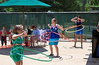 Walt Disney World, FL - May 2009 - Girls compete in hula-hoop contest at Walt Disney's Fort Wilderness Resort in Florida