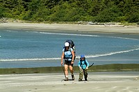 mother and son hiking,on Flores Island, West Coast, British Columbia, Canada