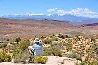 Visitor at Fiery Furnace overlooking Salt Valley Arches National Park Moab Utah