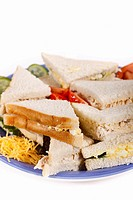 Cocktail sandwiches stacked on a plate  Isolated  Copy space