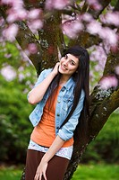 Portland, Oregon, United States Of America, A Teenage Girl Leaning On A Tree In Portland Park
