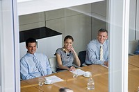 Smiling business people sitting in conference room