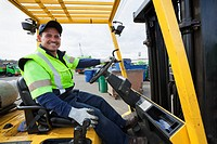 Hispanic man driving forklift