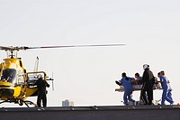 Medical personnel rushing patient to helicopter (thumbnail)