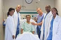 Doctors in hospital standing with patient