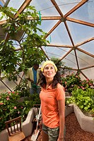 Ecuadorian woman looking up in greenhouse