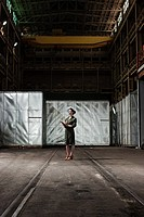 Businesswoman in warehouse