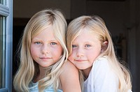 Blond twin girls, portrait