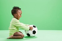 Baby boy playing with football