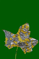 Paisley maple leaf on green background
