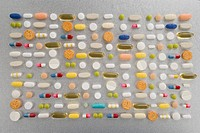 Rows of pills on grey background