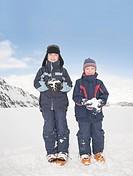 Boys 8_11 holding snowballs