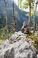 Boy sitting on a stone
