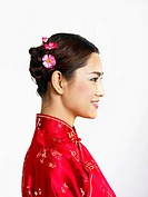 Profile of a young Chinese woman in cheongsam