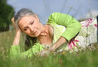 woman relaxing on meadow