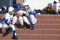 Boys in baseball uniform taking a break from training