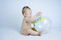 Baby Boy With Inflatable Globe