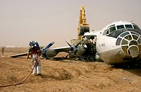 100728-N-0000M-005 HELMAND PROVINCE, Afghanistan July 28, 2010 A firefighter watches as a Seabee assigned to Naval Mobile Construction Battalion NMCB ...
