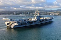 100731-N-7605J-797 PEARL HARBOR July 31, 2010 Sailors and Marines man the rails aboard the aircraft carrier USS Ronald Reagan CVN 76 as the ship arriv...