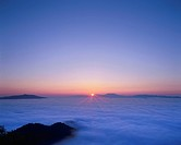 The Sun Rising Over Shiretoko Peninsula and a Blanket of Cloud. Hokkaido, Japan