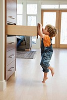 Boy looking in drawer