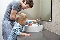 Boy washing hands (thumbnail)