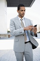 Businessman using cell phone